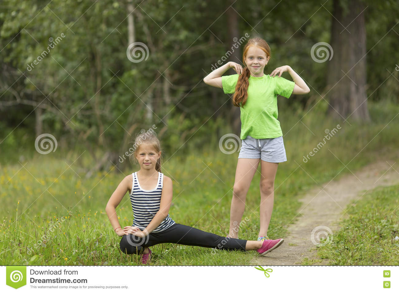 Two little cute girls warming up outdoors