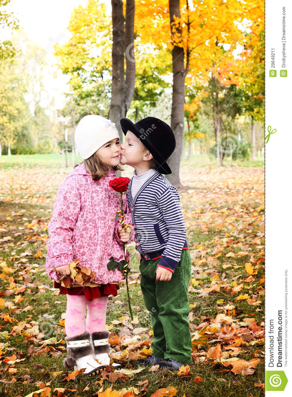 two little cute kids dating with hand lifts onto shoulder in autmn