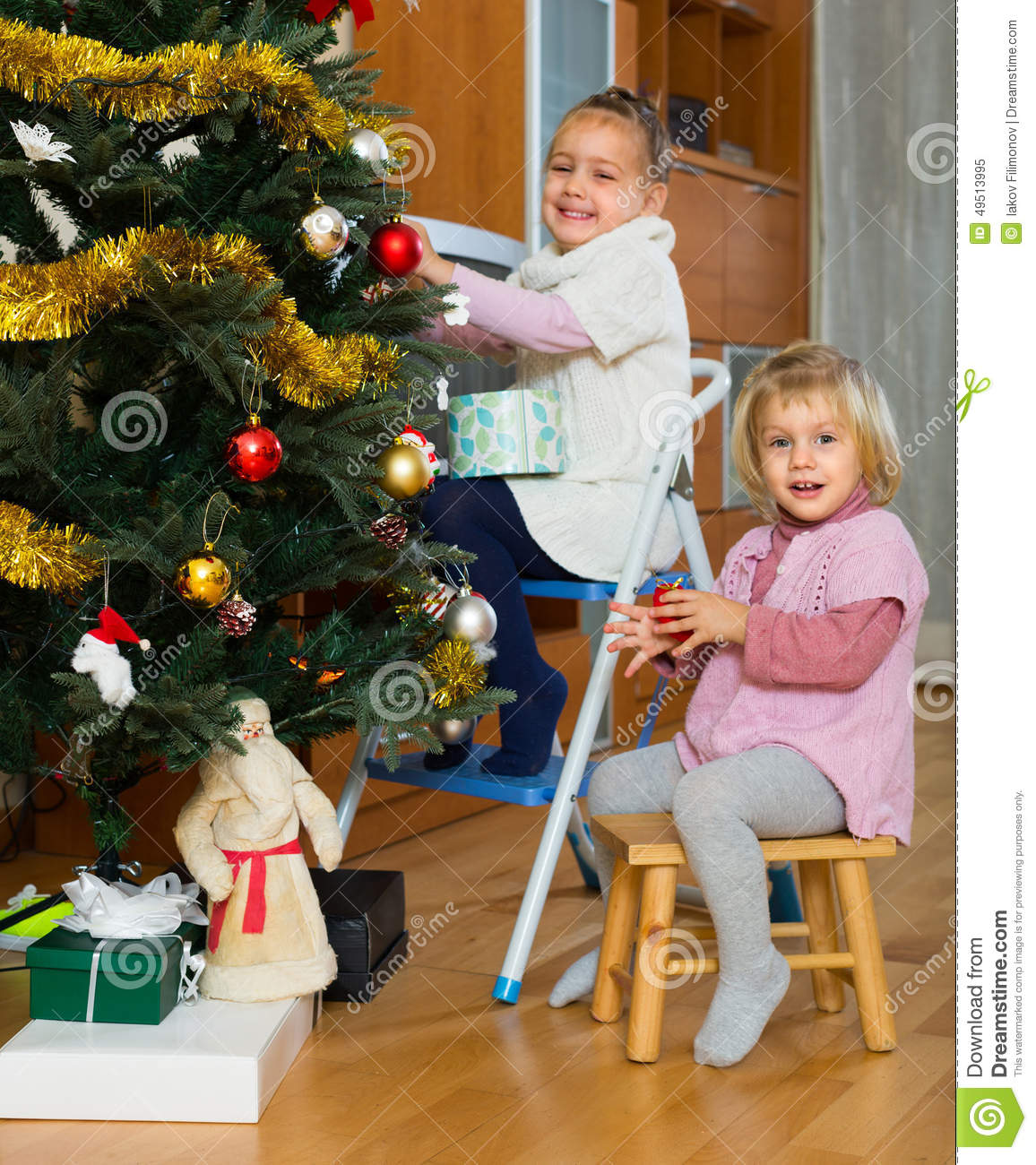 Little Girl Christmas Tree: Two Little Girls Decorating Christmas Tree Stock Photo
