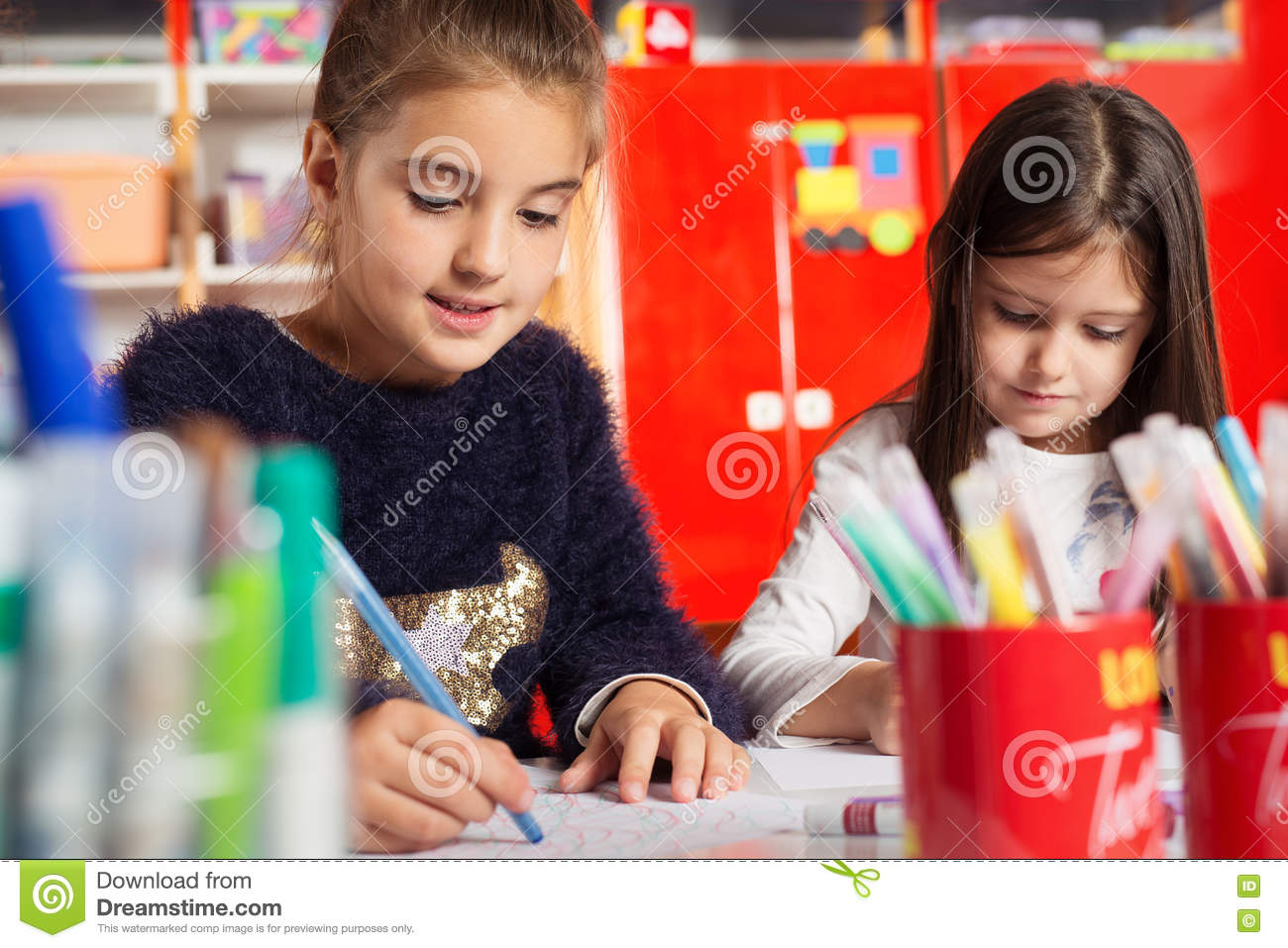 drawing games for little girls Two Little Girls Drawing On Paper At Table Stock Image