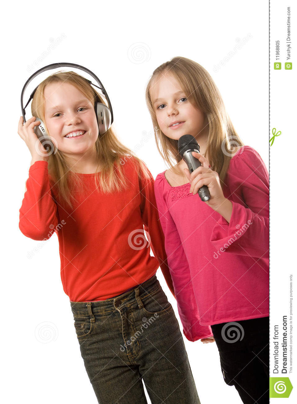 Two little girls with headphones and microphone