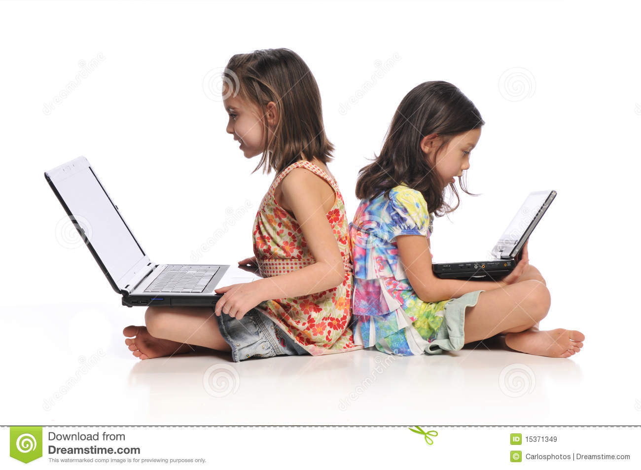 Two little girls with laptop computers