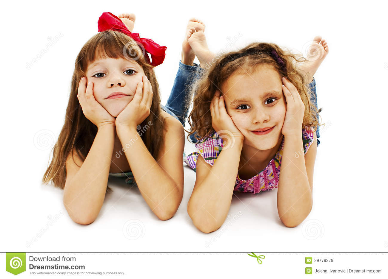 Two Little Girls Are Lying On The Floor Stock Image ...
