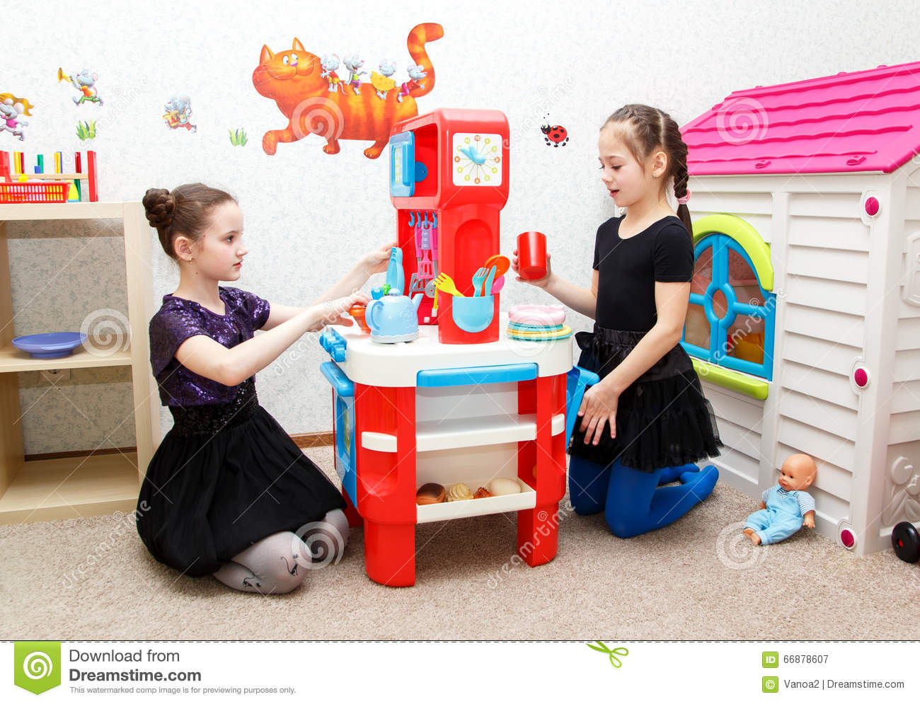 Toys For Day Care Centers : Two little girls play role game with toy kitchen in day
