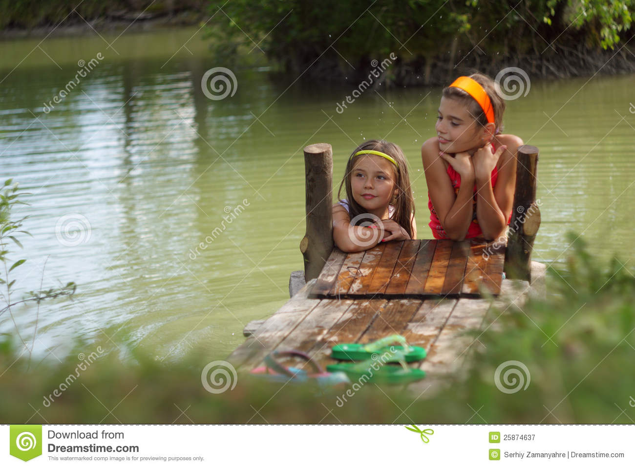 0c4ad04e7 Two Little Girls Playing In The Farm Lake Stock Image - Image of ...