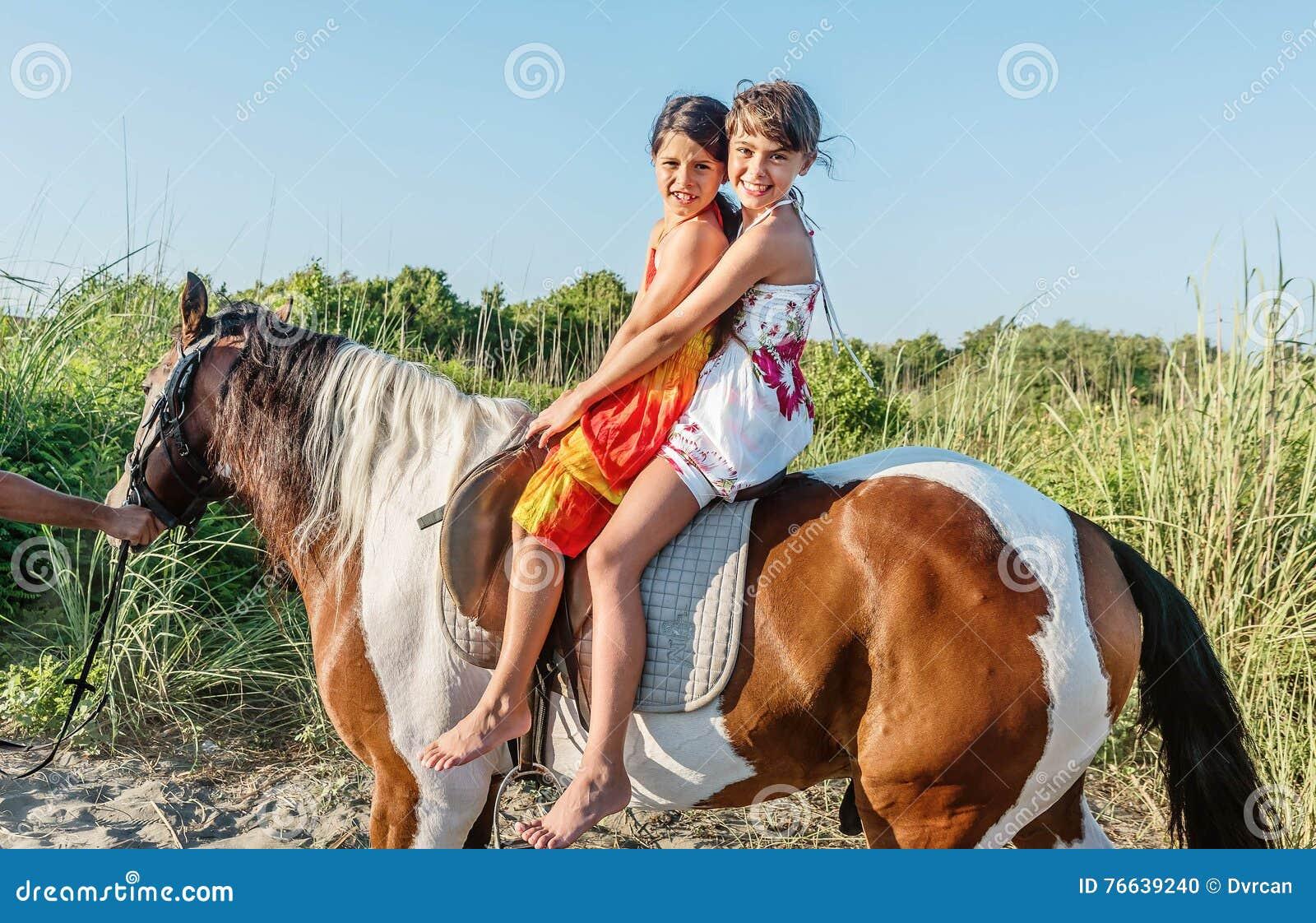 Two Little Girls Riding Horse In The Summer Ada Bojana Monte
