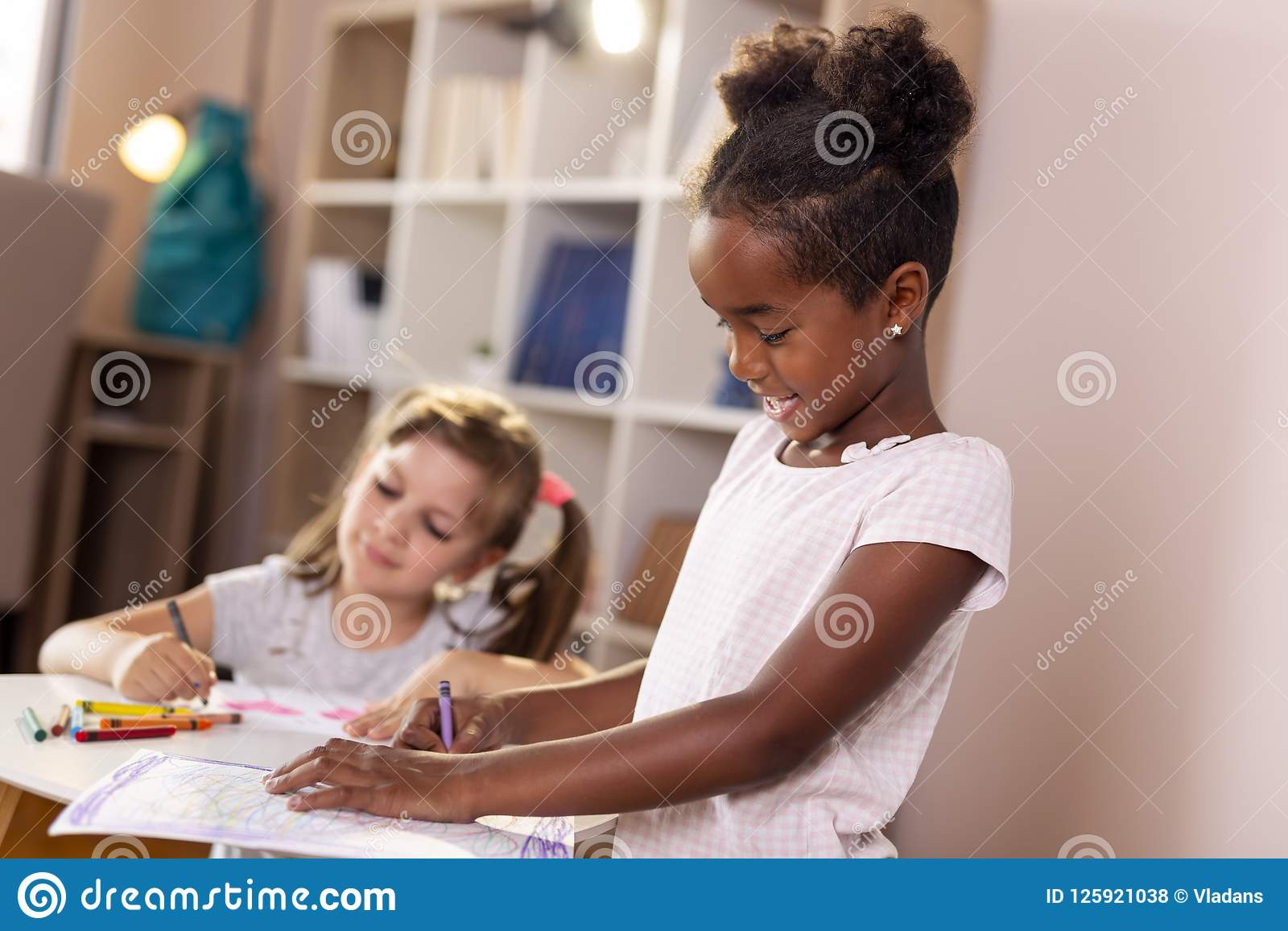 Girls drawing with crayons