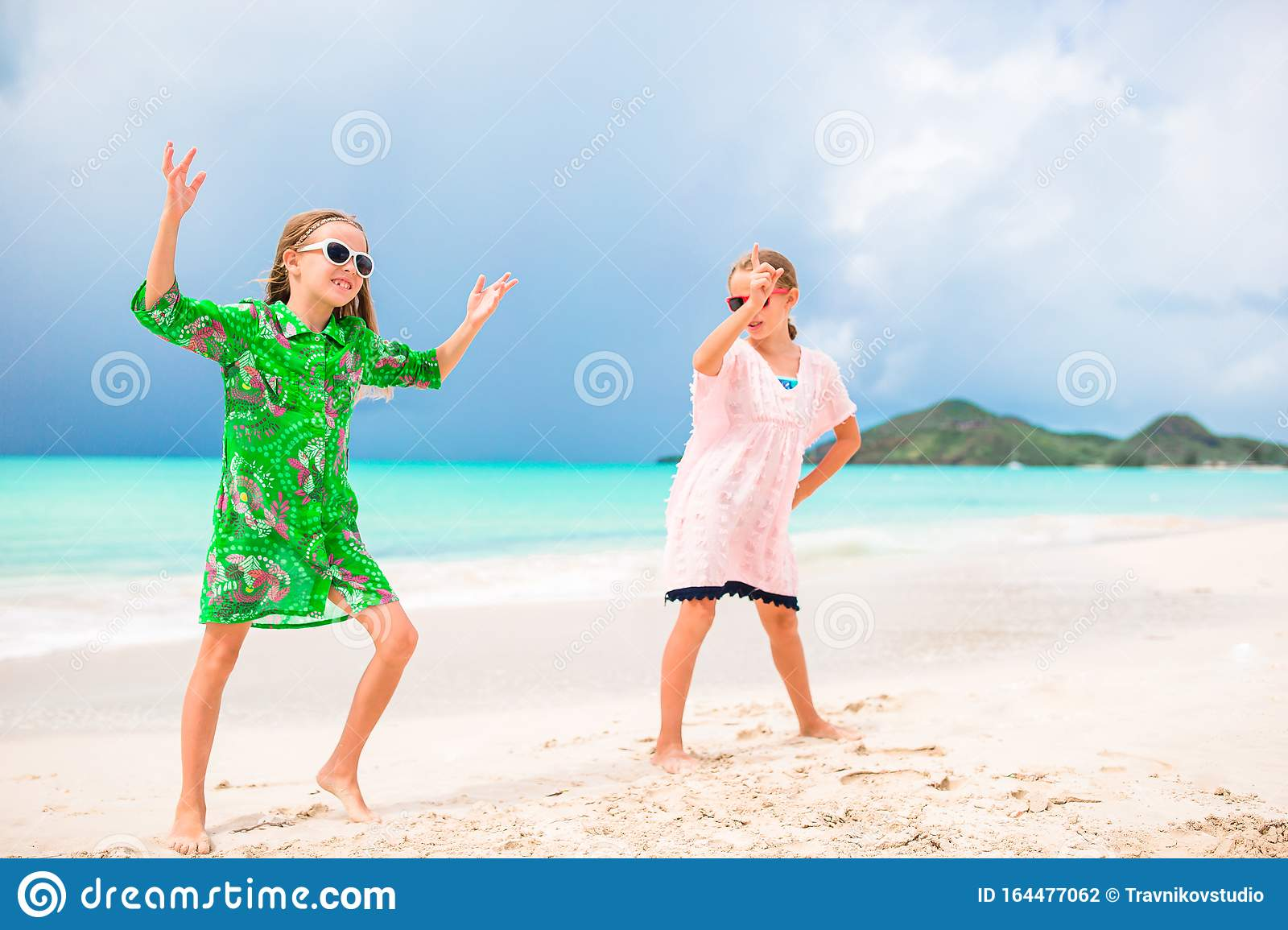 Two Little Happy Girls Have A Lot Of Fun At Tropical Beach