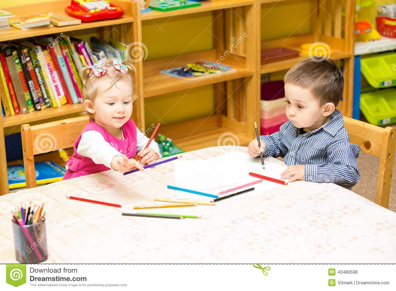Kinder Garden: Two Little Kids Drawing With Colorful Pencils In Preschool