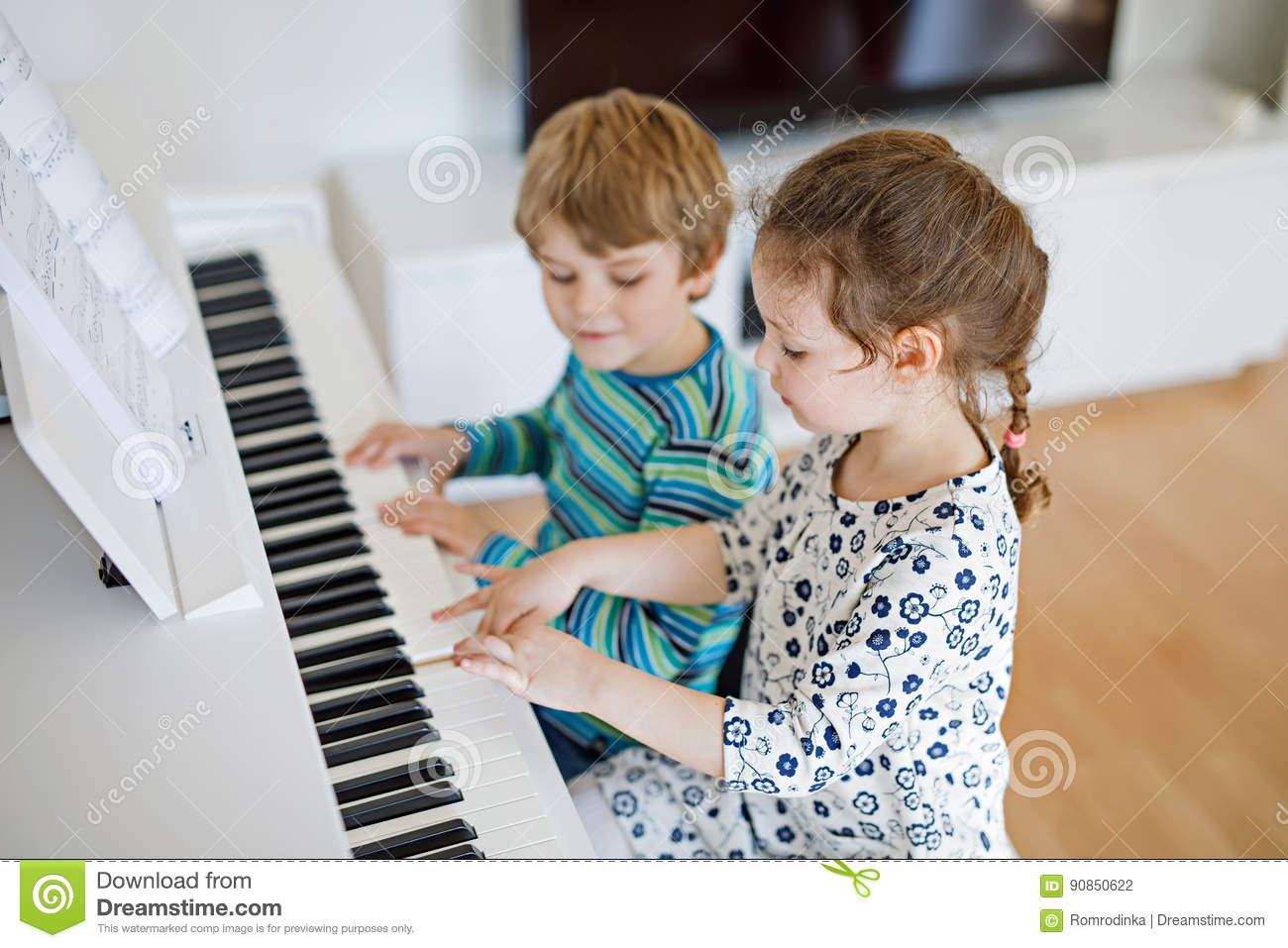 Kinder Garden: Two Little Kids Girl And Boy Playing Piano In Living Room
