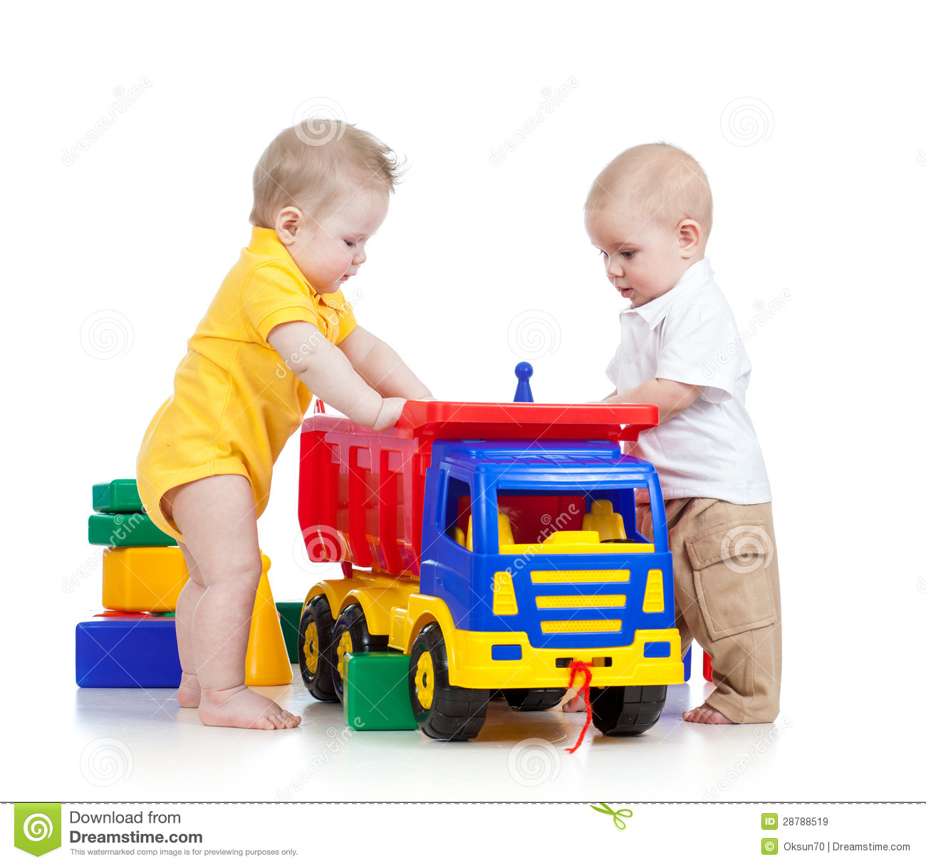 Toys For Little : Two little kids playing with color toys royalty free stock