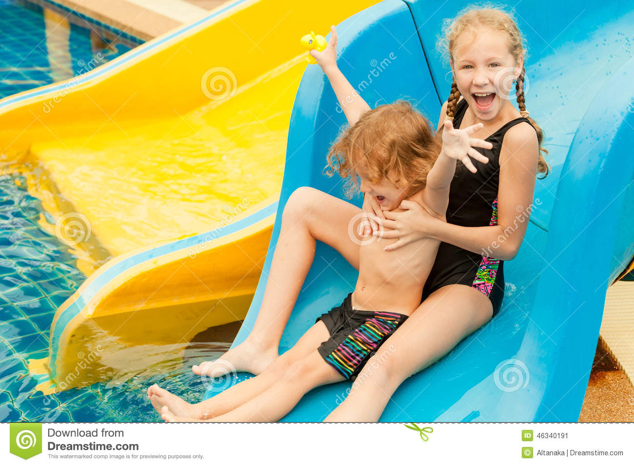 Two little kids playing in the swimming pool stock image for Pool time pools