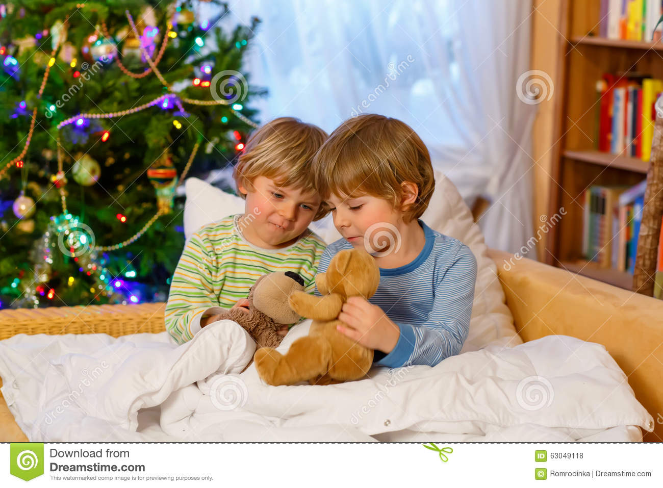 Two Little Sibling Boys Playing Toys On Christmas Stock Photo
