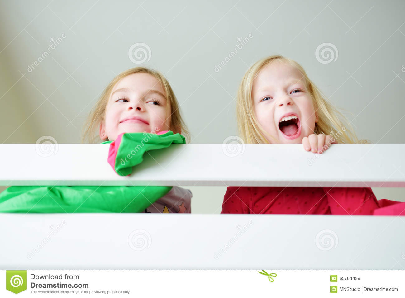 Two Little Sisters Fooling Around, Playing And Having Fun ...
