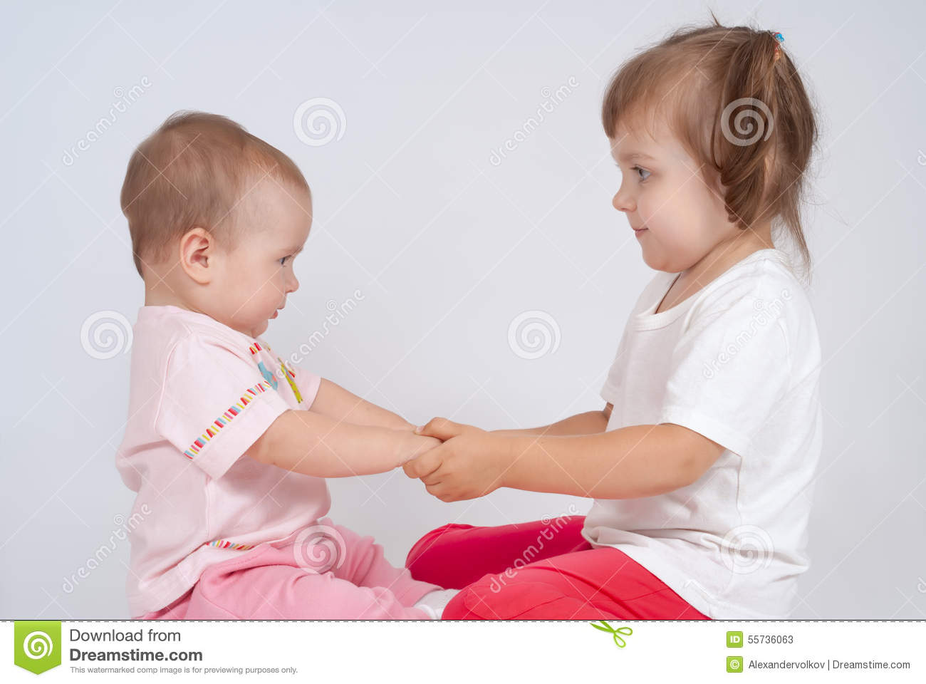 Two Little Sisters Are Holding Hands Stock Photo - Image ...
