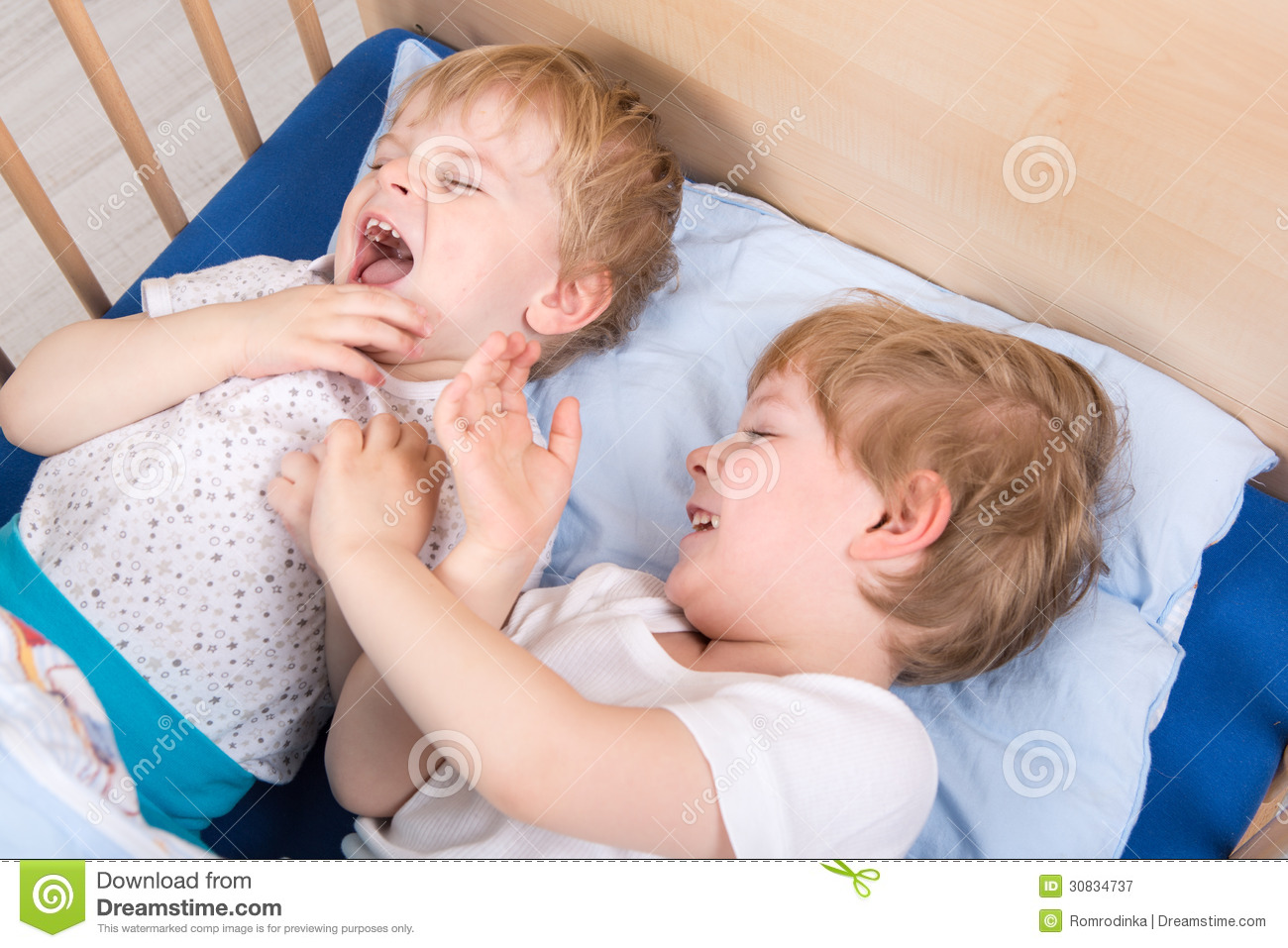... Free Stock Photography: Two little toddler boys having fun in bed