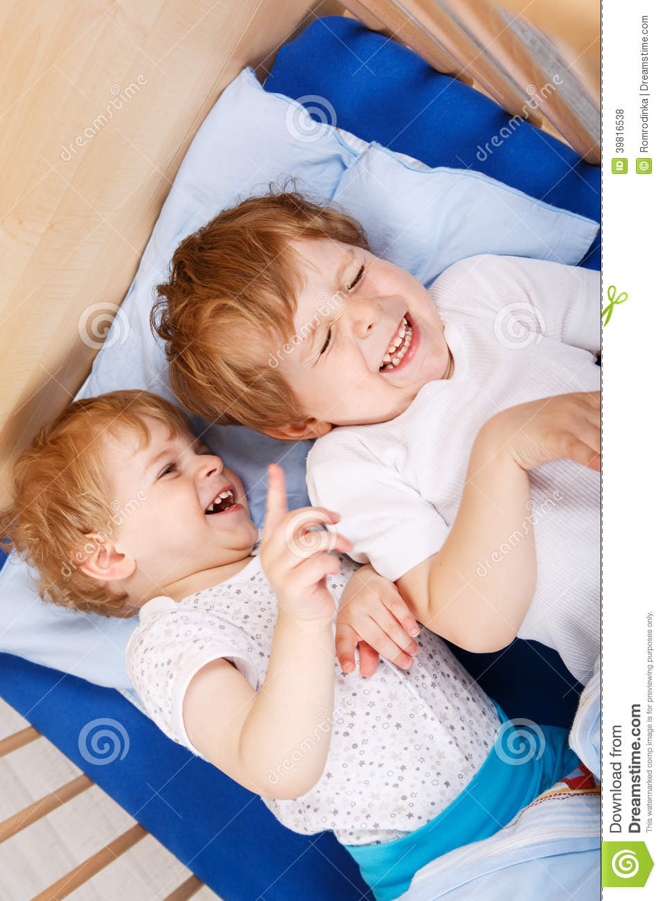 Two Little Toddler Boys Having Fun And Fighting Stock