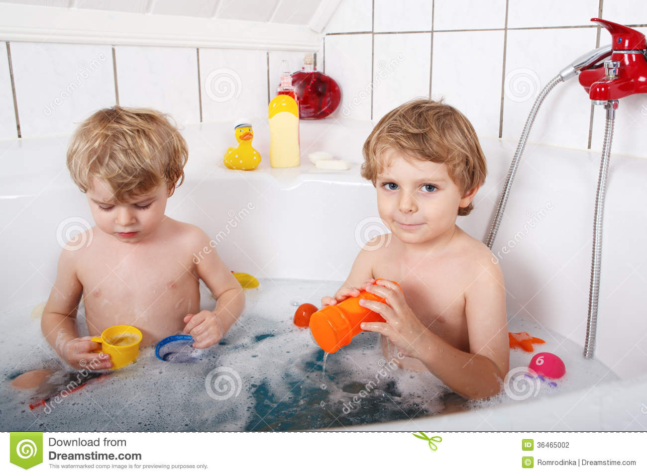 Two Little Twins Boys Having Fun With Water By Taking Bath In Ba ...