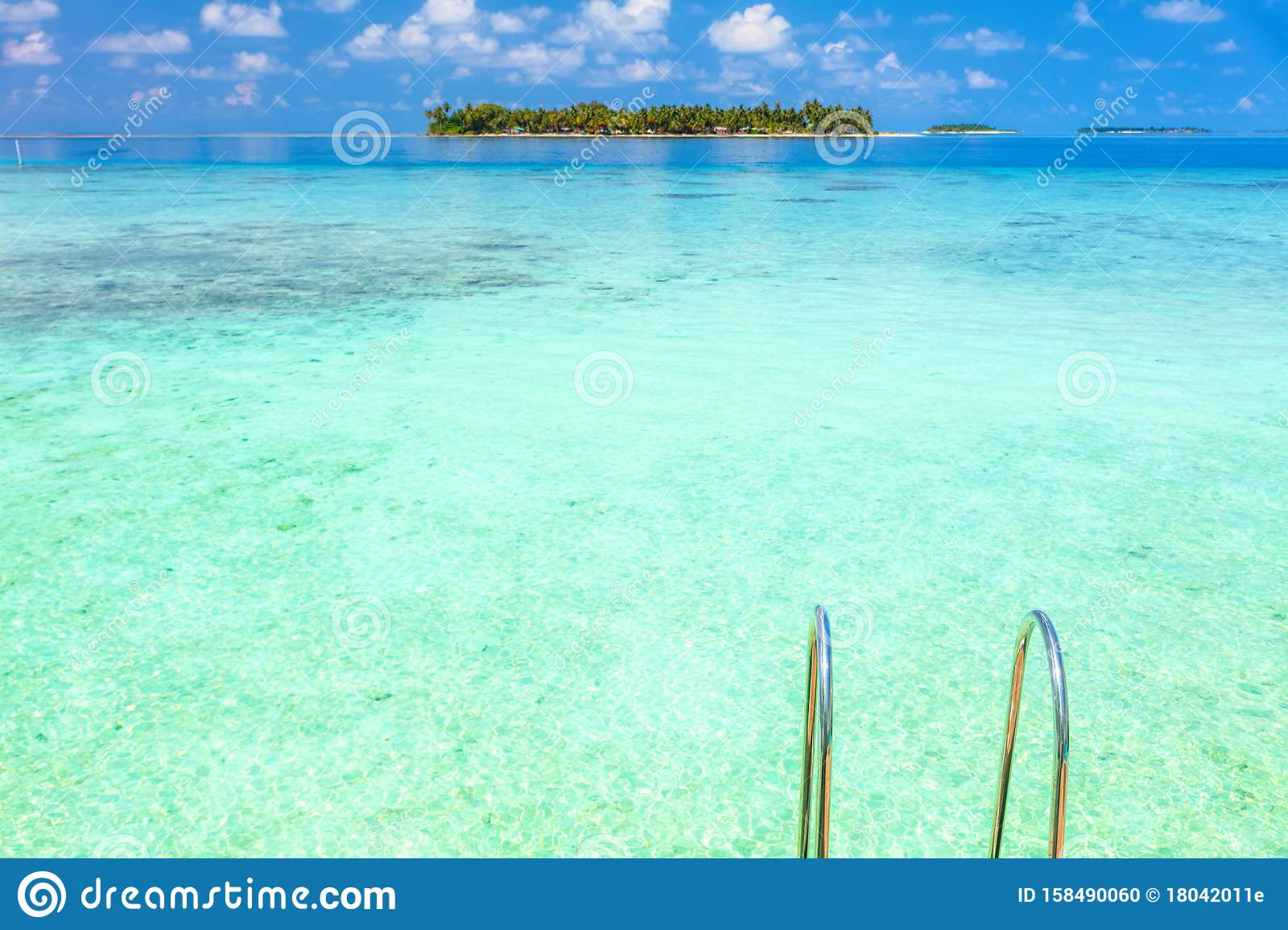 Outdoor Natural Gas Fire Pit Table, Two Lounge Chairs On The Wooden Deck With Maldives Turquoise Water Sea View For Summer Vacations Holiday Concept Stock Photo Image Of Island Paradise 158490060