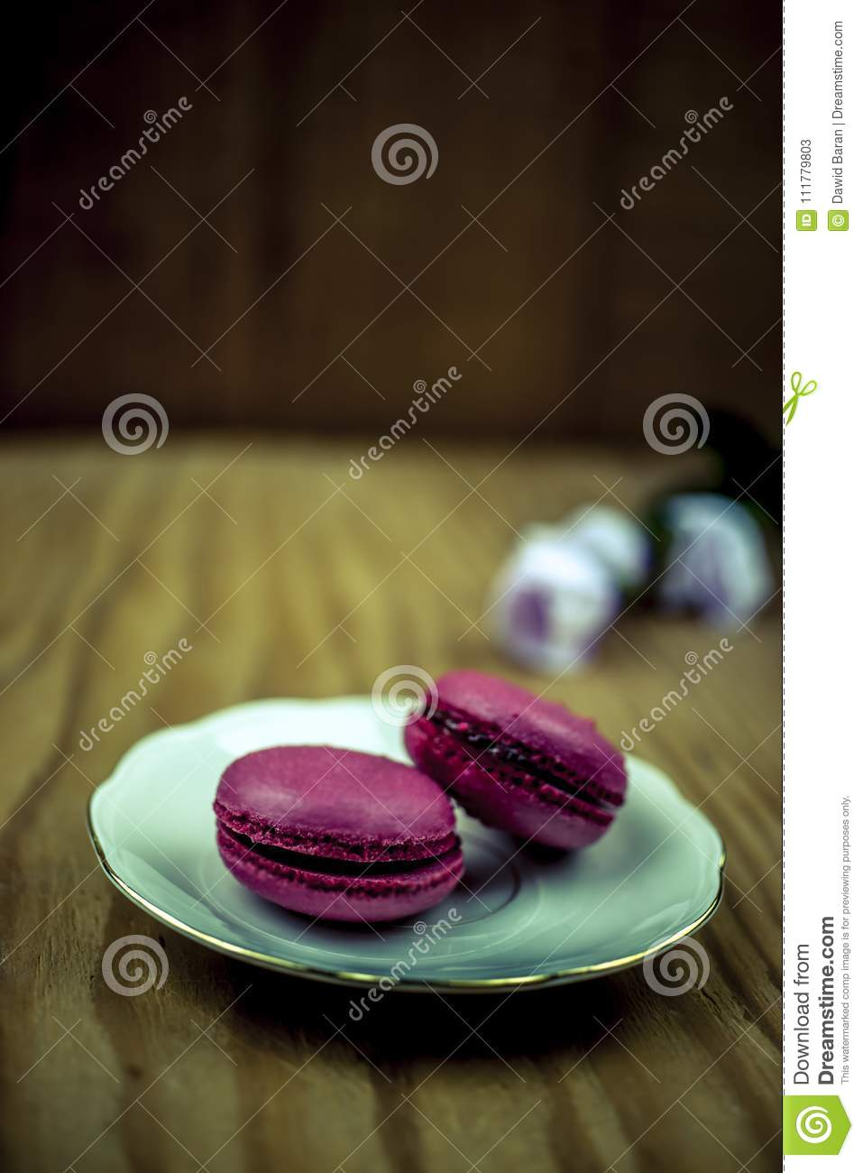 Two pink macaroons with flowers