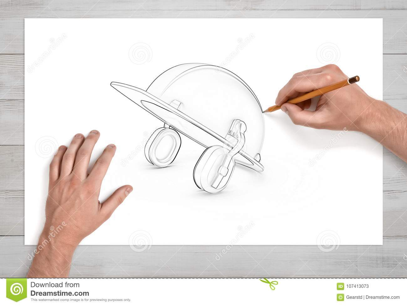 Two male hands draw a pencil sketch of an industrial hard hat with