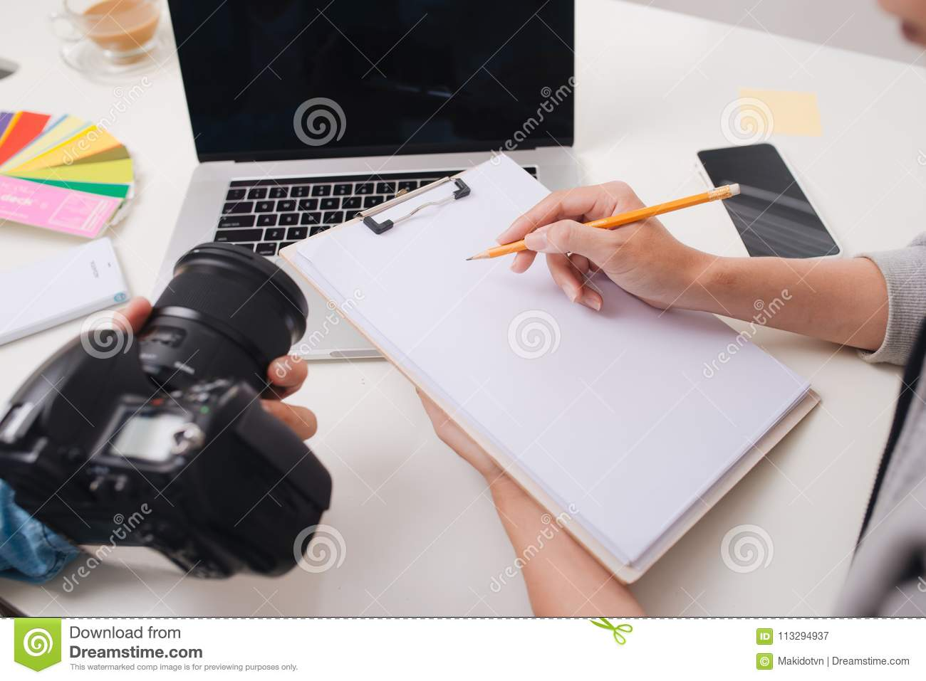Two male photograher meeting in creative office