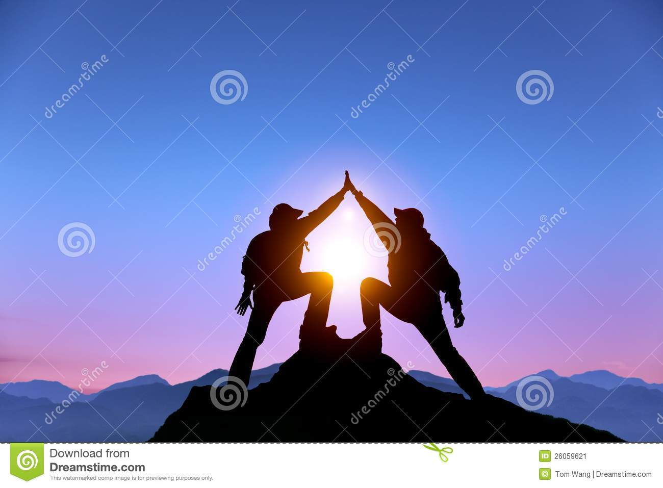 Two man with success gesture on the mountain