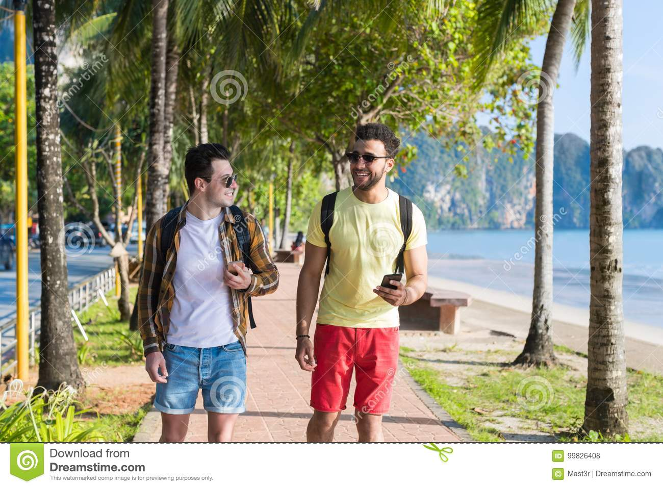 Two Man Using Cell Smart Phones Tropical Park Couple Chatting Online Holiday Sea Summer Vacation