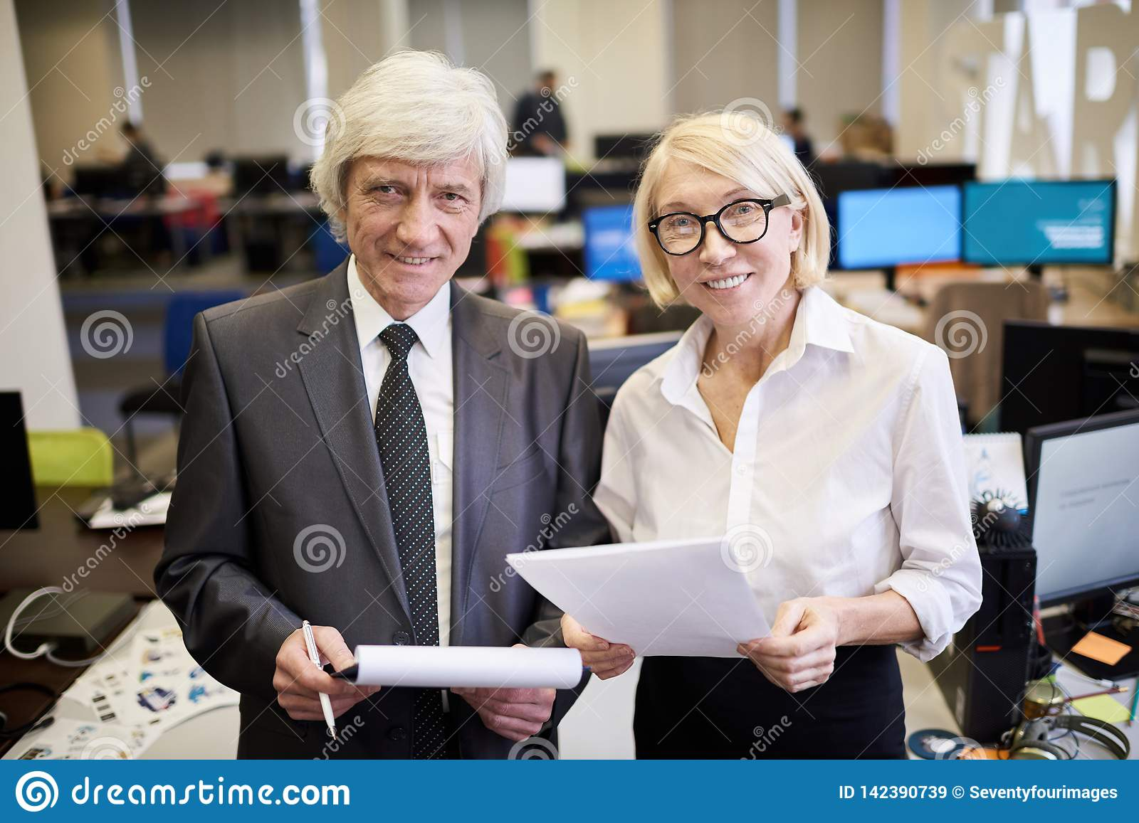 Two Mature Executives Posing in Office