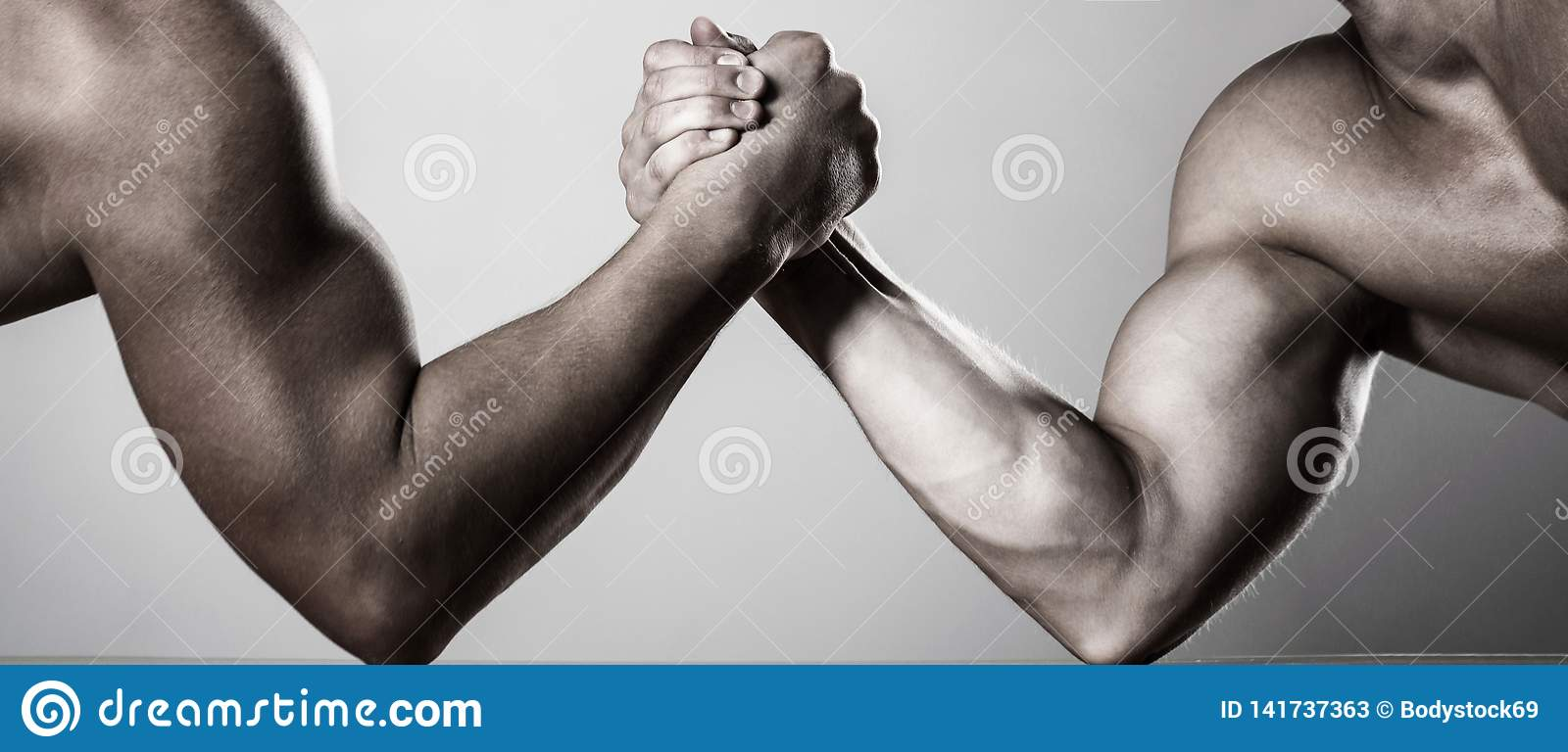 Two men arm wrestling. Rivalry, closeup of male arm wrestling. Two hands. Men measuring forces, arms. Hand wrestling