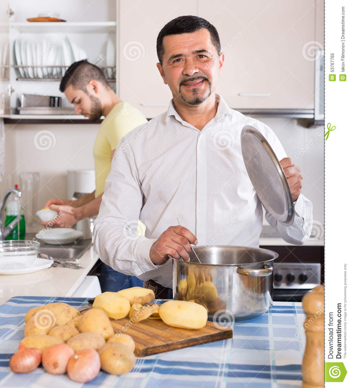Two Men Cooking At Home Stock Photo - Image: 53767765