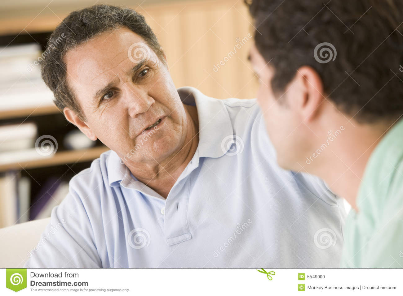 Two Men In Living Room Talking Stock Photo Image 5549000