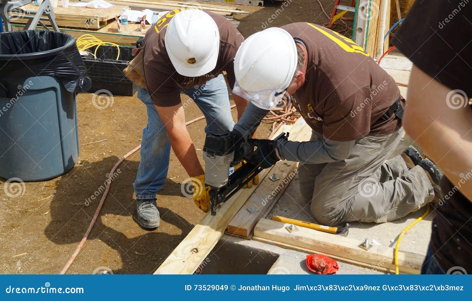 Two men nailing