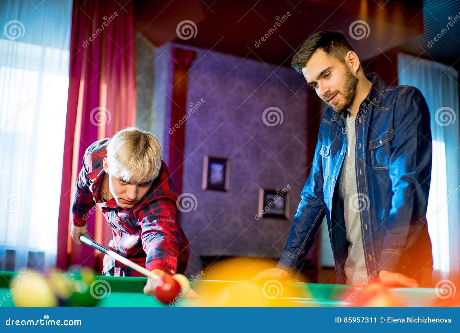 Billard game played but two guys that start playing