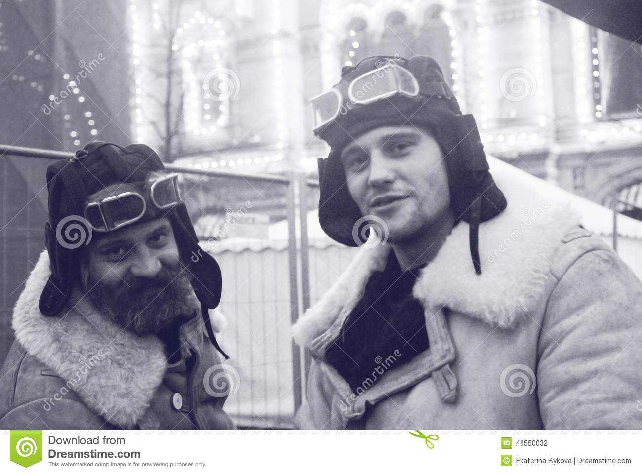 MOSCOW - NOVEMBER 07, 2014: Two men in vintage military winter clothes pose  for a photo on the Red Square in Moscow on the occasion of anniversary of  ...