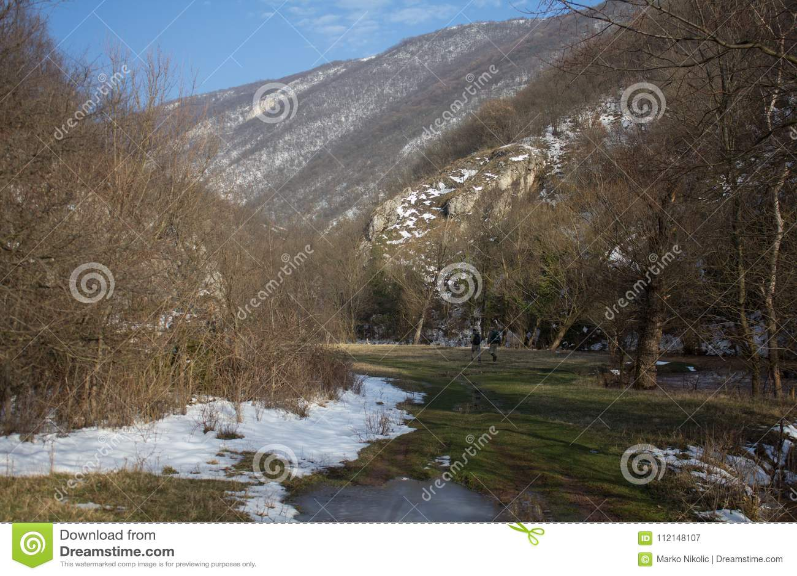 Two men walk through the valley,