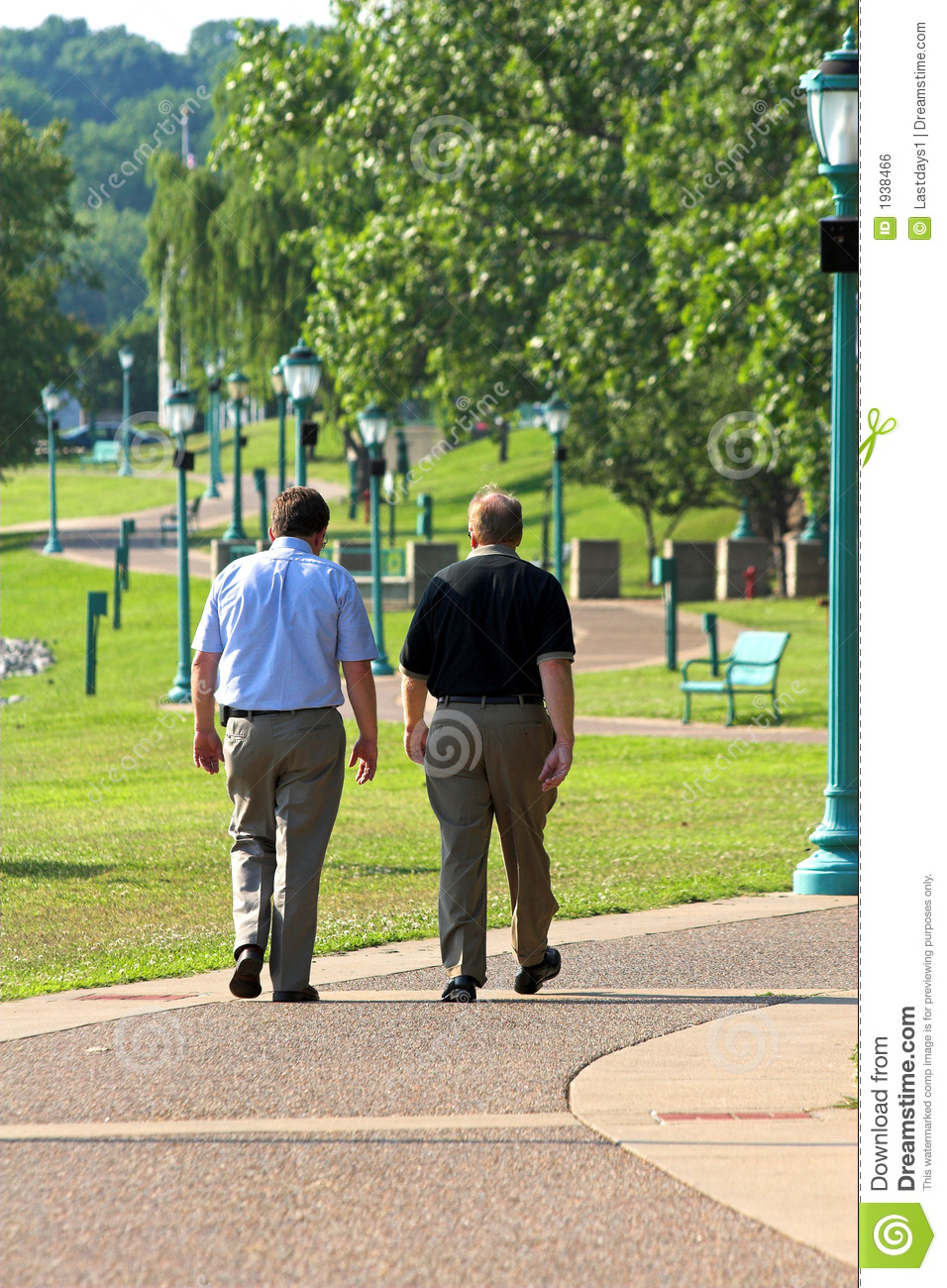 Only Metaphor >> Two Men Walking stock photo. Image of blue, busy, body - 1938466