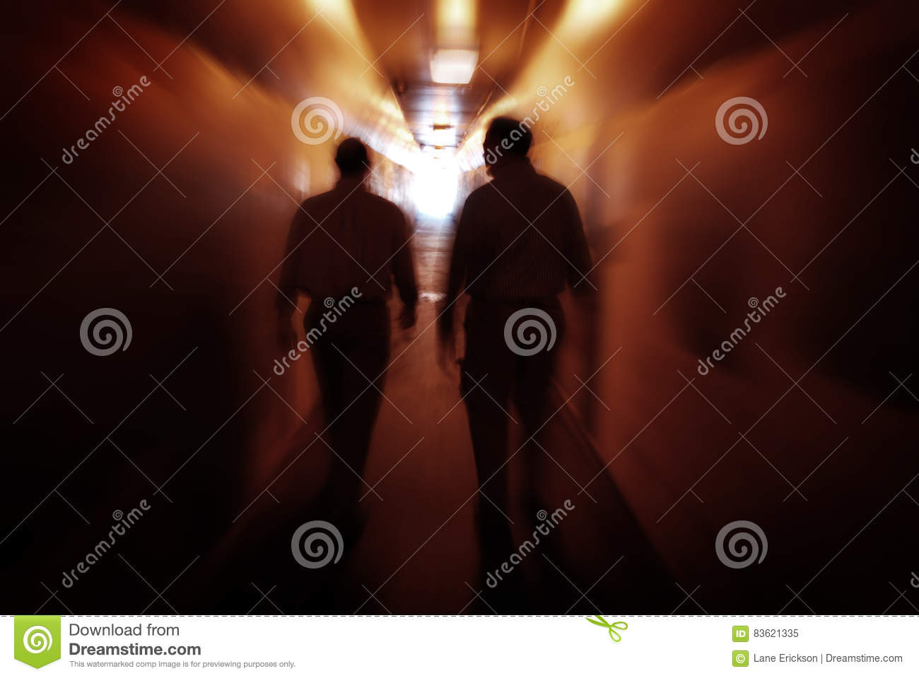 Two men walking through Tunnel Exploring New Places