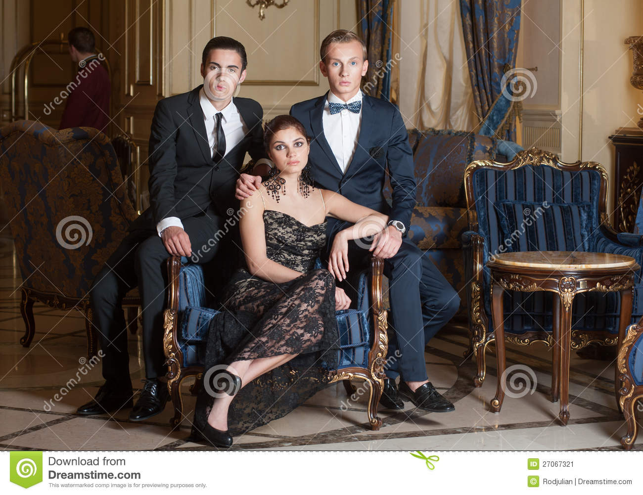 Two Men And Woman Posing For Group Photo Stock Image