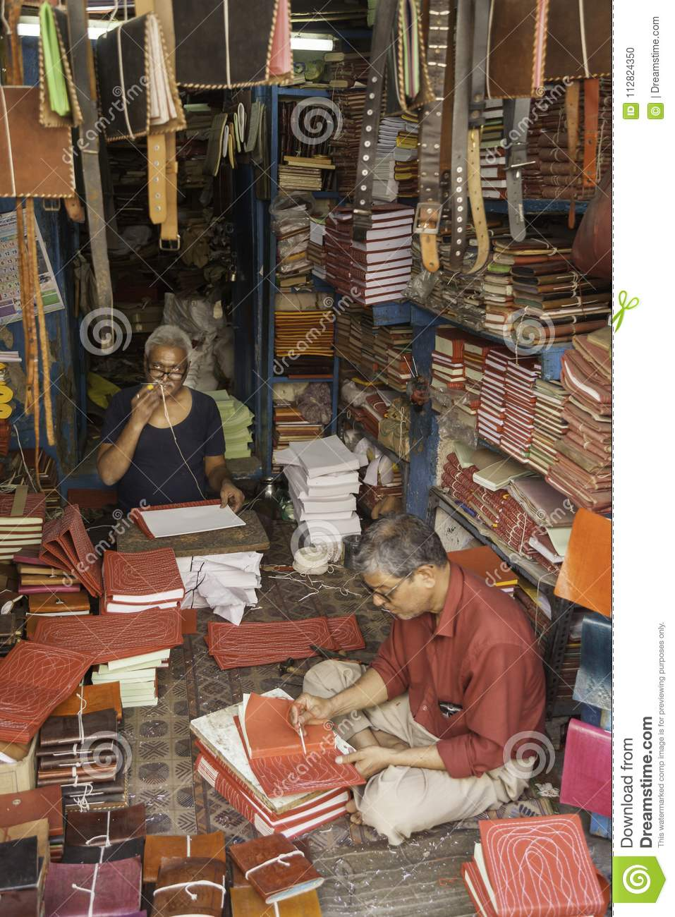 Two Men at Work in Their Bookshop