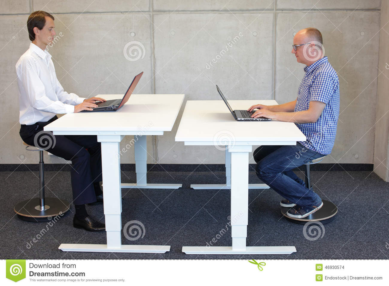 Two Men Working In Correct Sitting Posture On Pneumatic