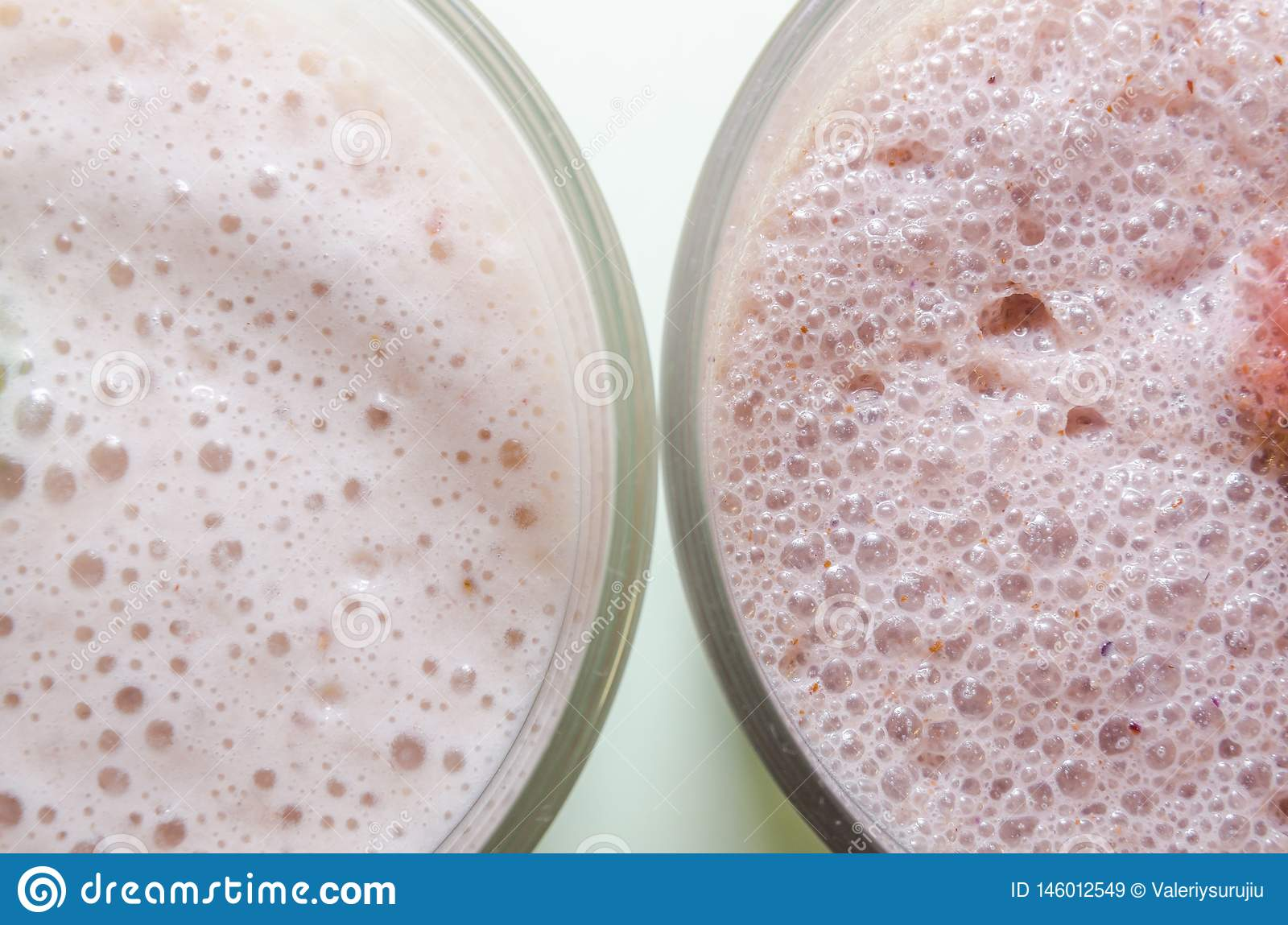 Two milkshakes with banana and strawberry