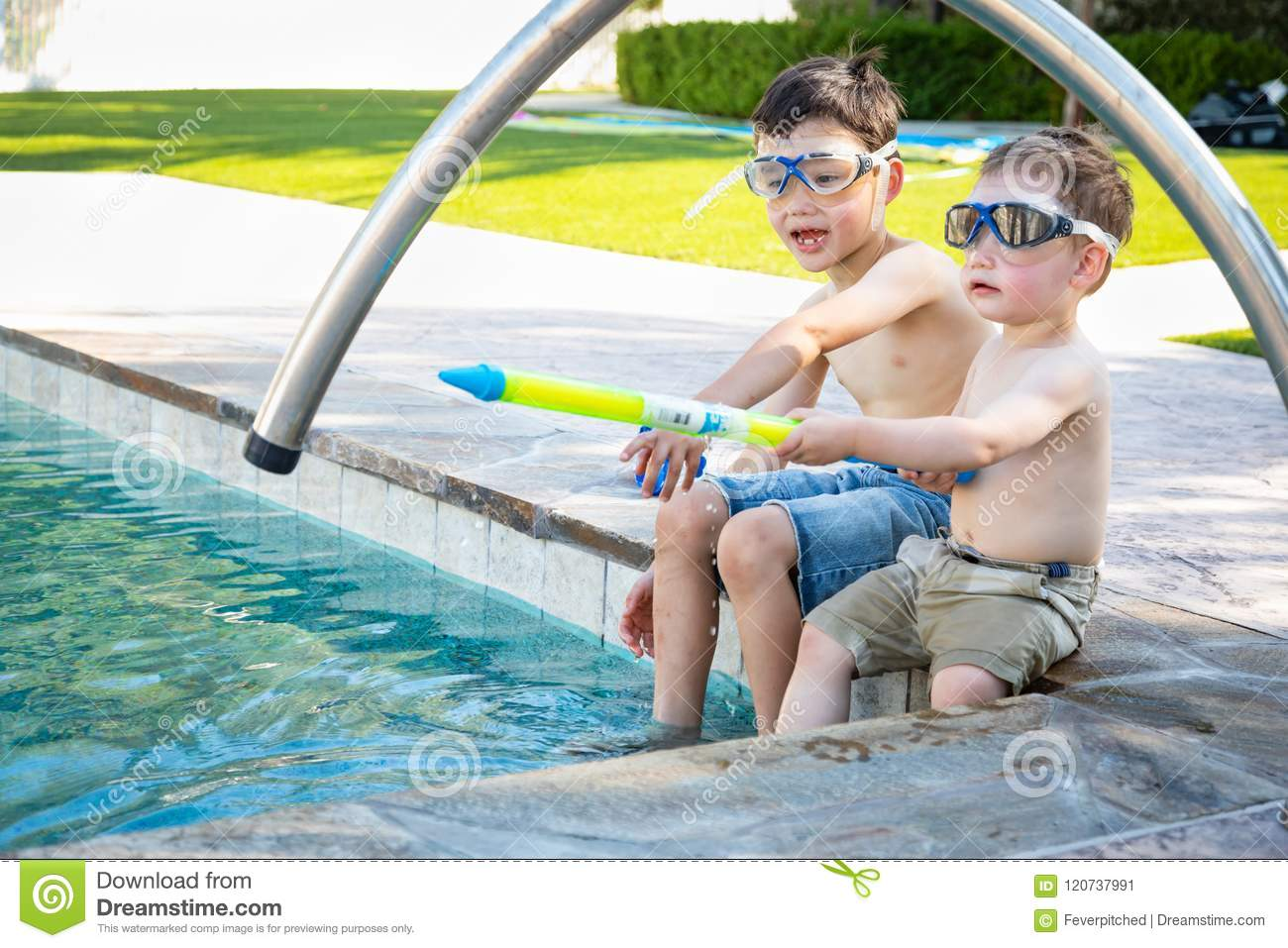 Two Mixed Race Chinese Caucasian Brothers By the Pool in Swimming Goggles
