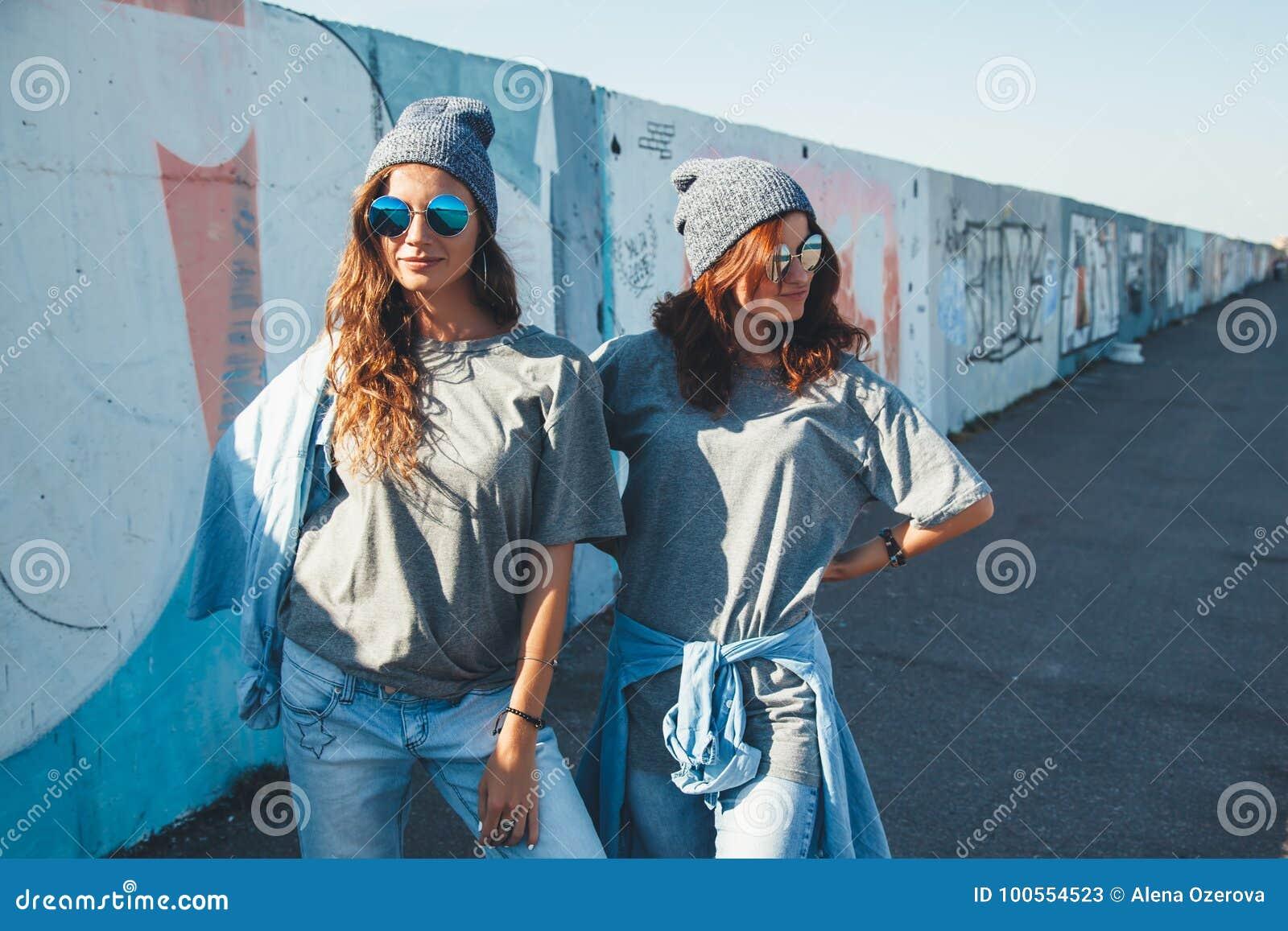 Models Wearing Plain Tshirt And Sunglasses Posing Over