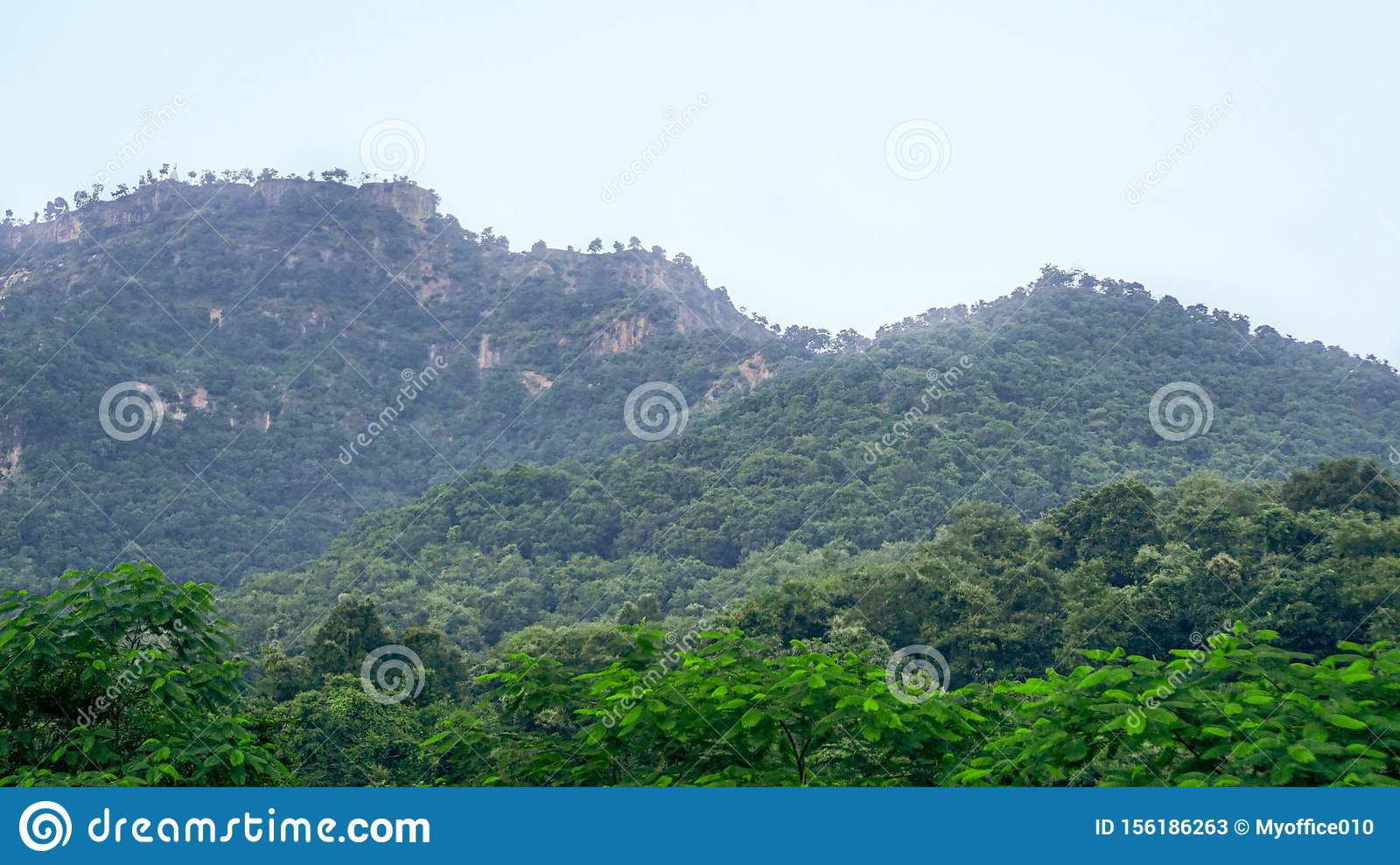 Two mountain peaks with forest at the base at Maharashtra, India.