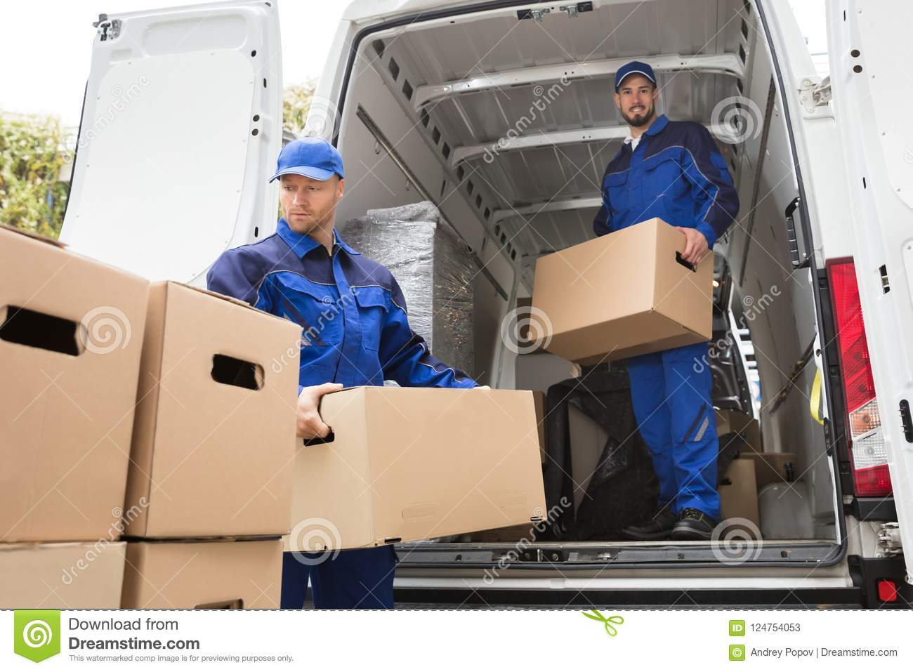 Two Movers Carrying Cardboard Box