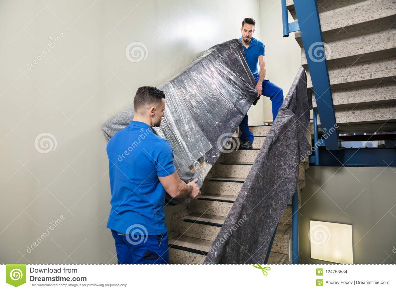 Two Movers Carrying Furniture On Staircase Stock Photo Image Of
