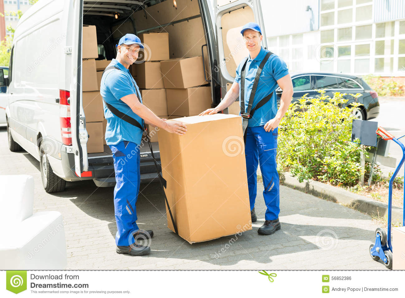 Mover Two Man Loading Furniture On Truck Royalty Free