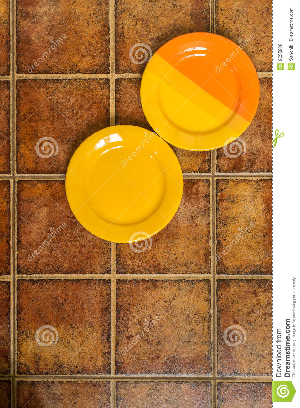 Two Multi-colored Plates In A Corner On A Brown Background Stock ...