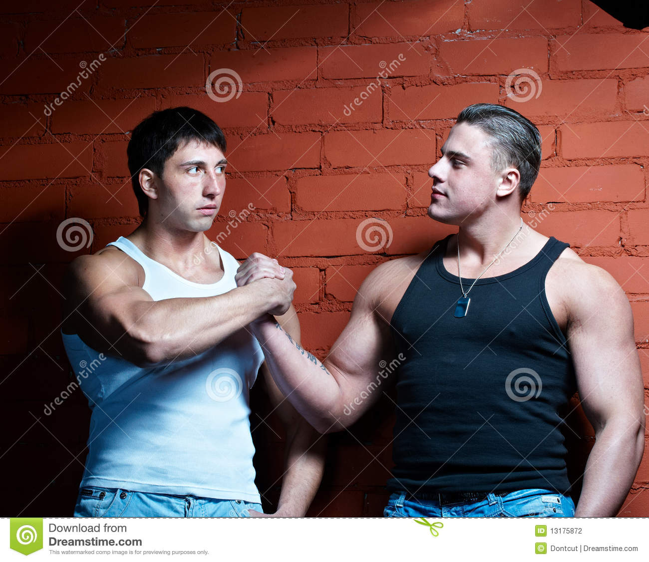 Two muscular guys